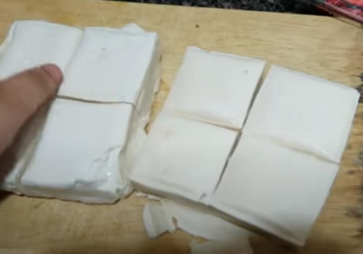 Cut blocks of tofu into four.