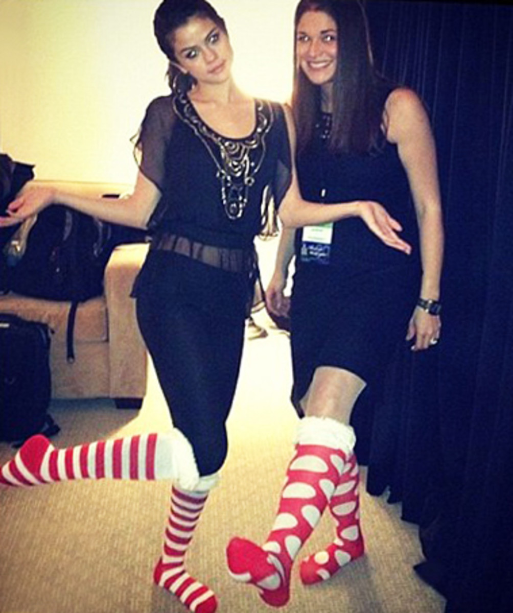 Selena Gomez in Christmas Striped Socks