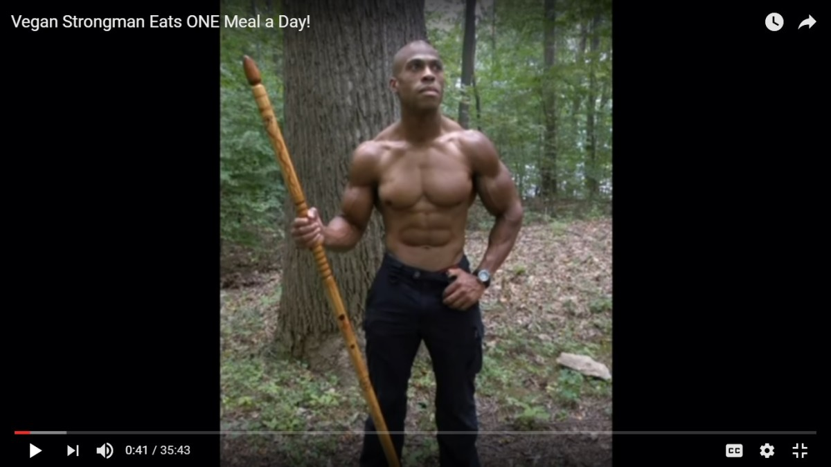A picture of a vegan strongman who only eats one time a day. His name is Dr. Nun S. Amen Ra Dr.PH, MA, MSW, LGSW. Click on for larger picture with this or other ones. He is a Doctor of Public Health.