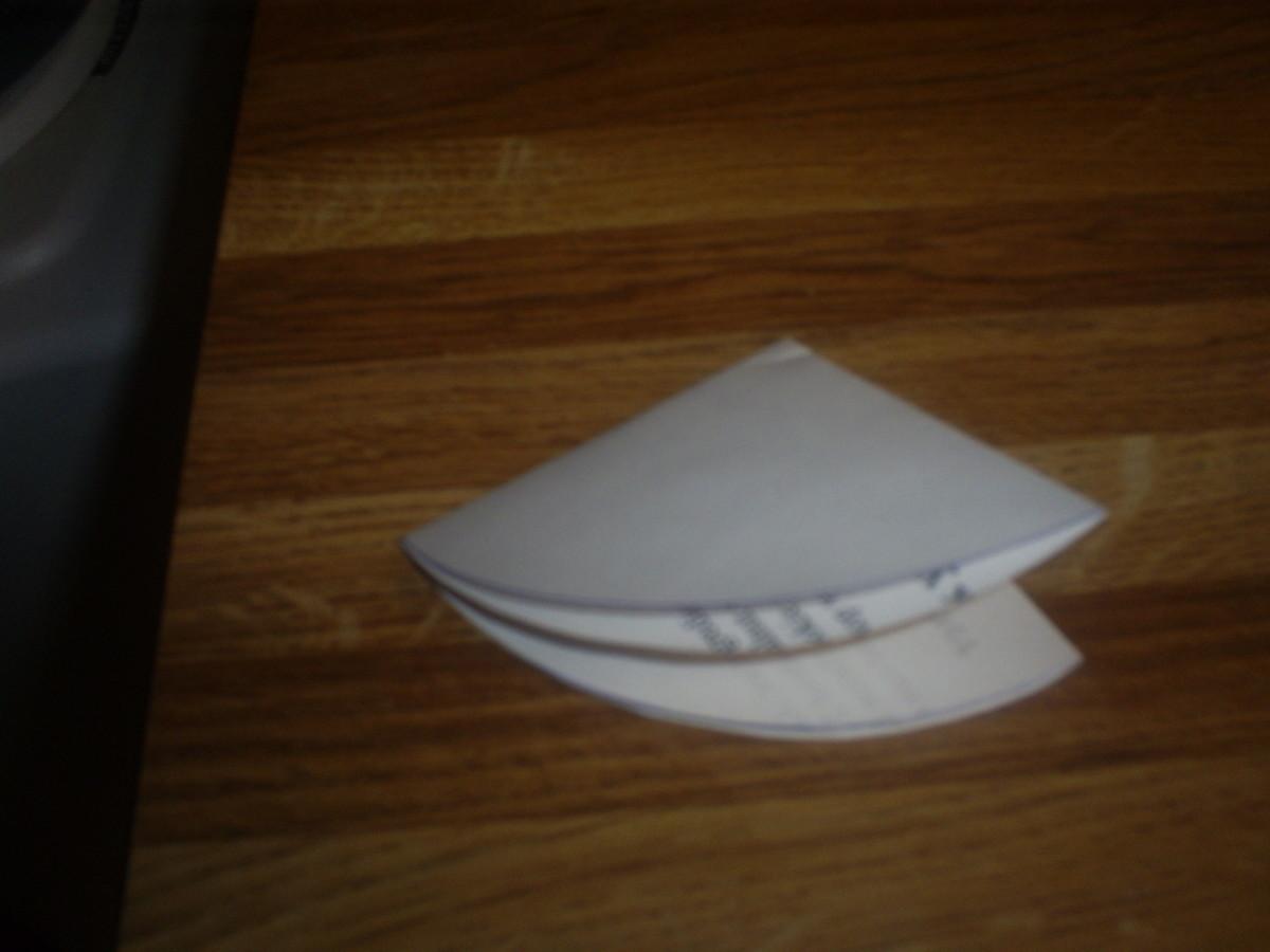 Fold the semicircle into a triangle.