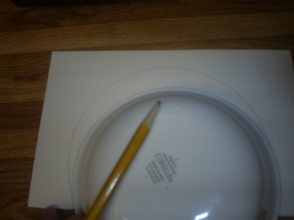 Trace around a bowl to make a round circle.  Cut out the round circle shape.