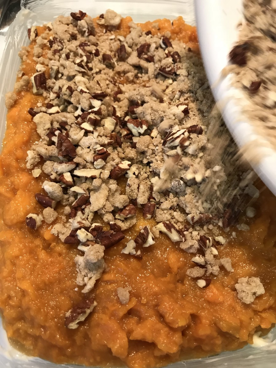 Spread the topping on the sweet potatoes, and bake at 350F for about half an hour, until golden brown on top and bubbly throughout.