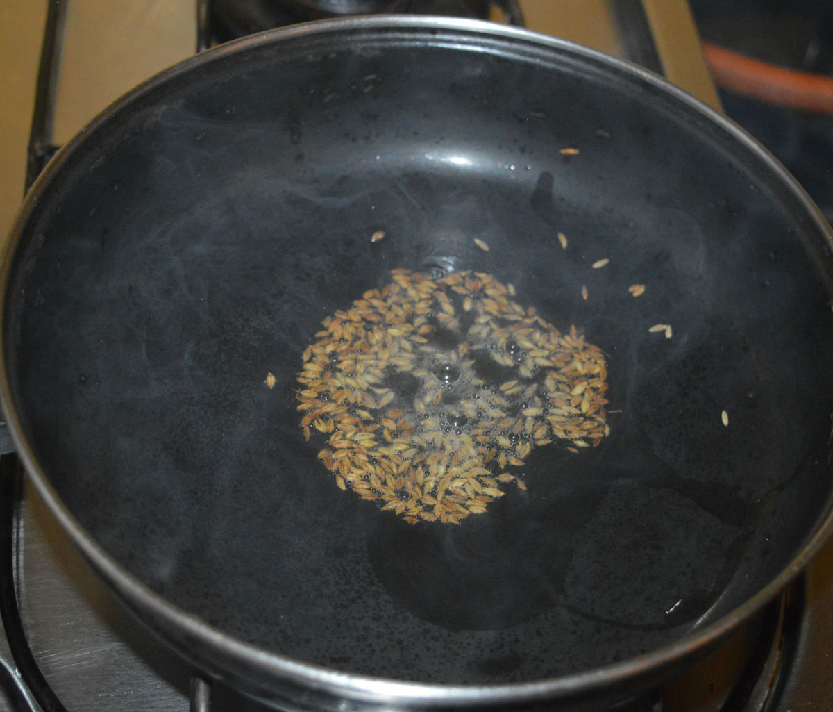 Heat oil in a deep-bottomed pan. Throw in the cumin seeds and allow them to crackle.