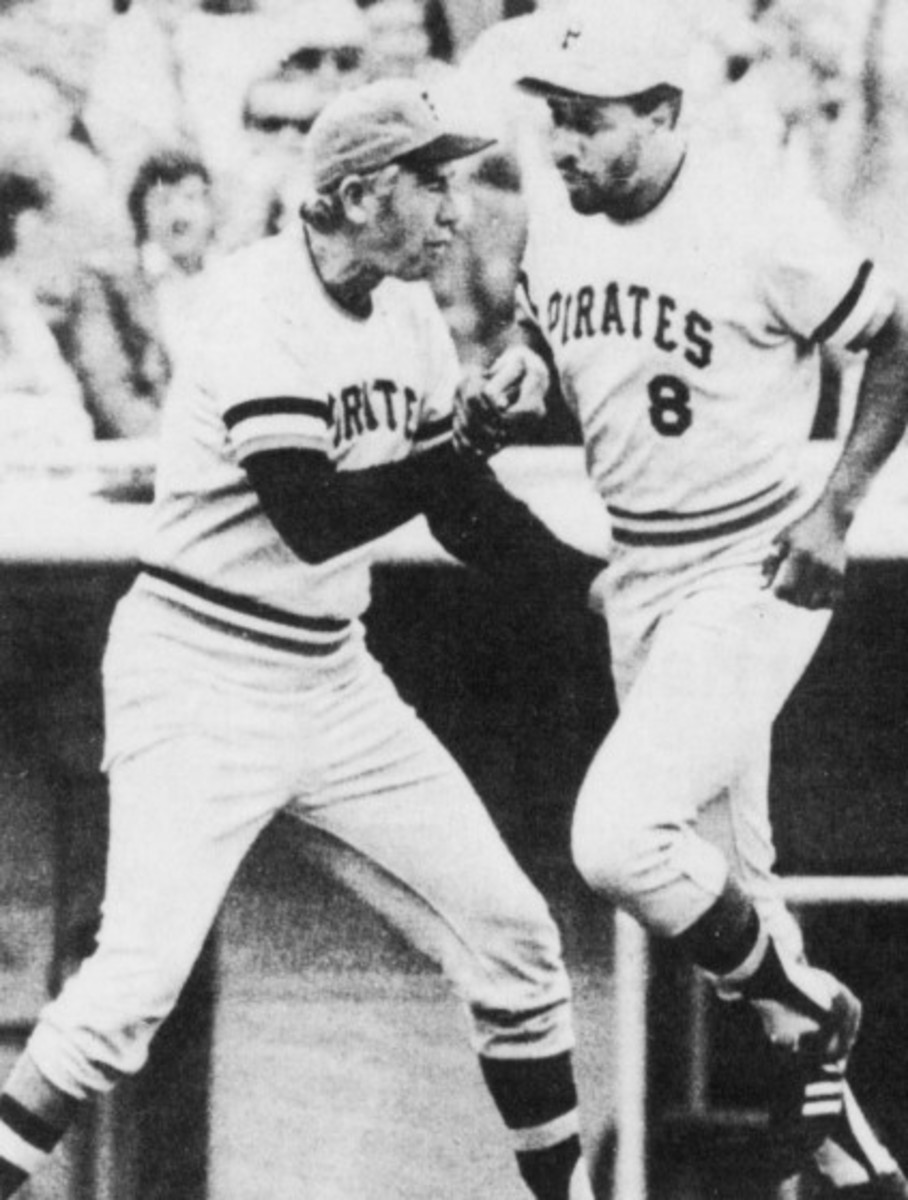 Pirates Hall of Famer Willie Stargell (8) is congratulated by third base coach Bob Skinner after hitting a home run in 1974.