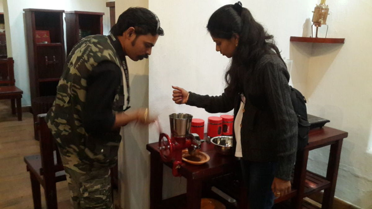 Coffee blending experience at The Verandah: Grinding the roasted coffee seed blend.