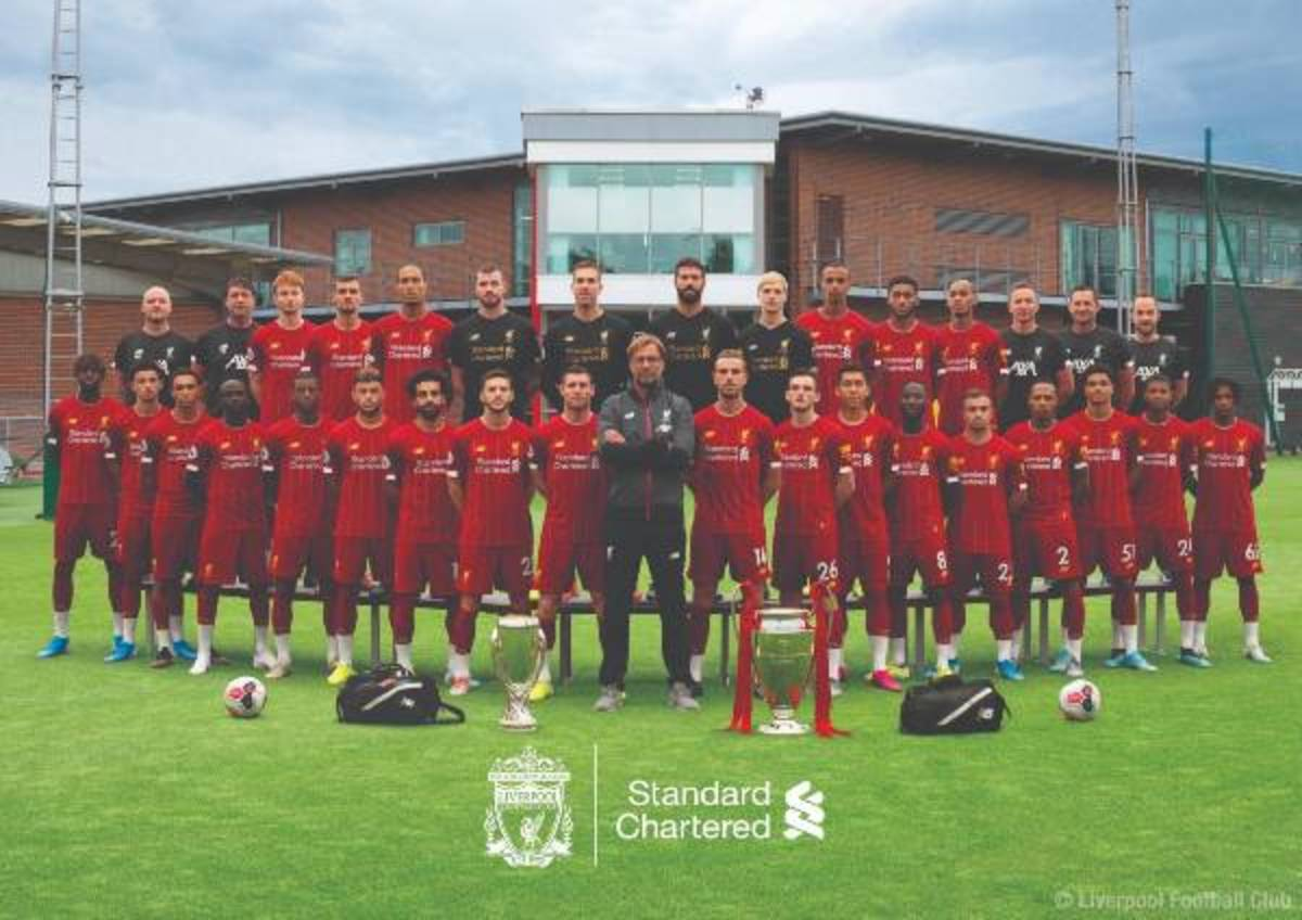 Klopp pictured with his staff and players.