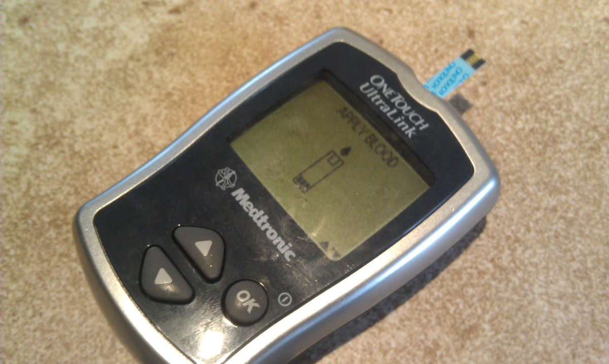 Diabetes test strip inserted into meter and meter ready for test