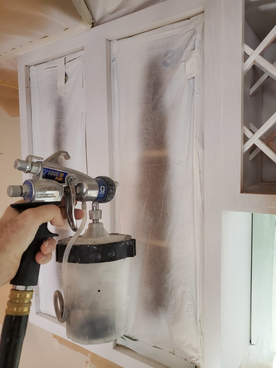 Me priming a small set of cabinets with my HVLP sprayer.