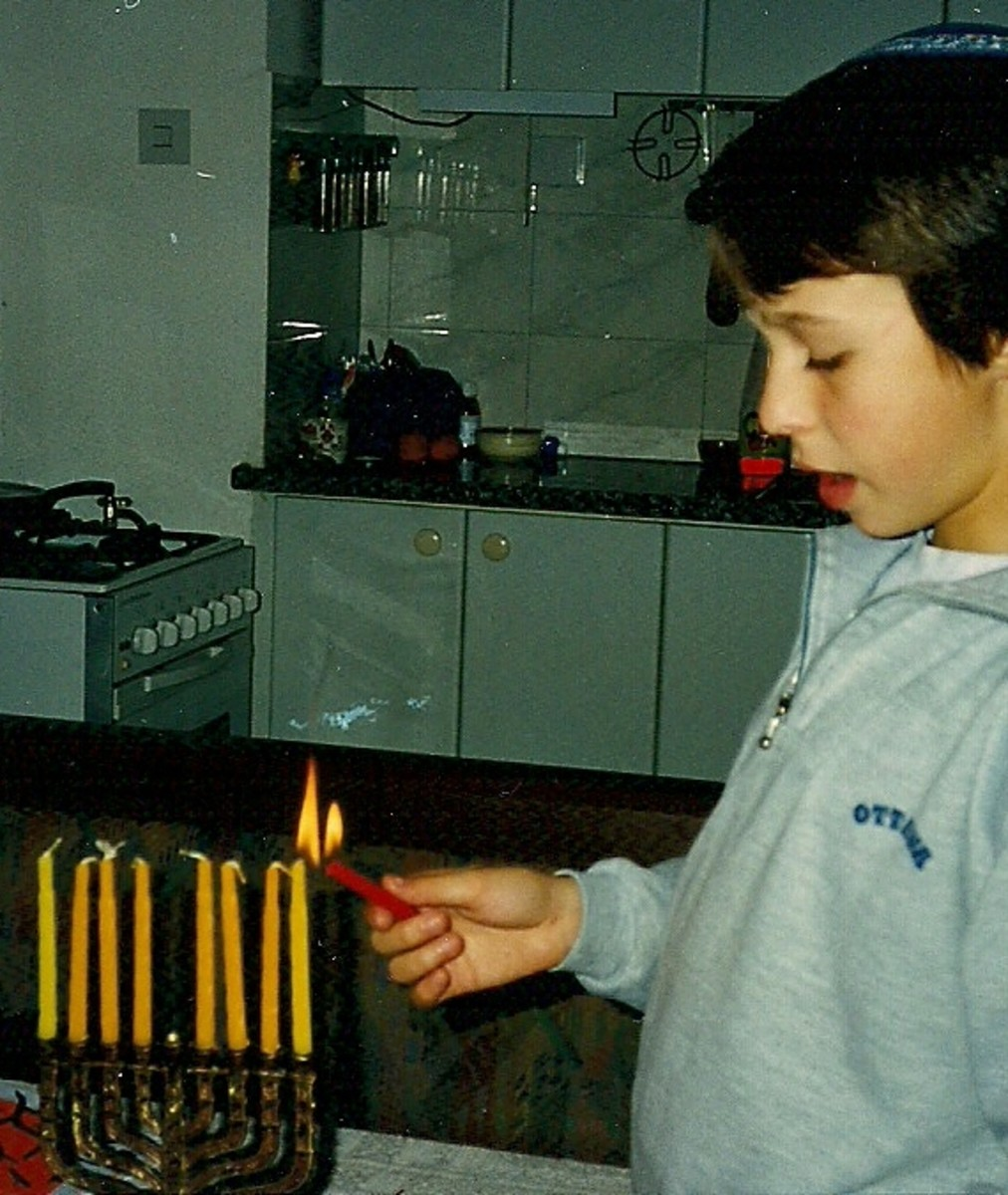 Reuven (then 10 years old) lighting the Hanukkia and singing blessings in Hebrew.