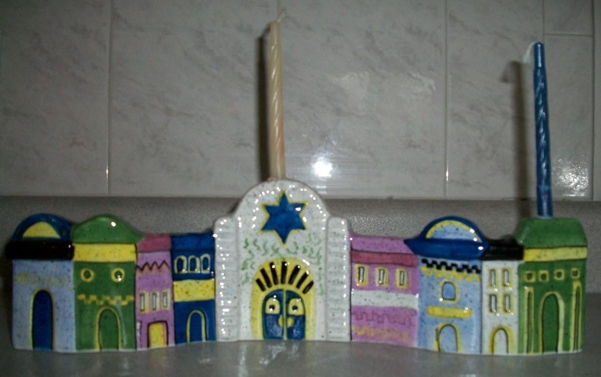 Decorative hanukkia in the shape of Jerusalem wall.