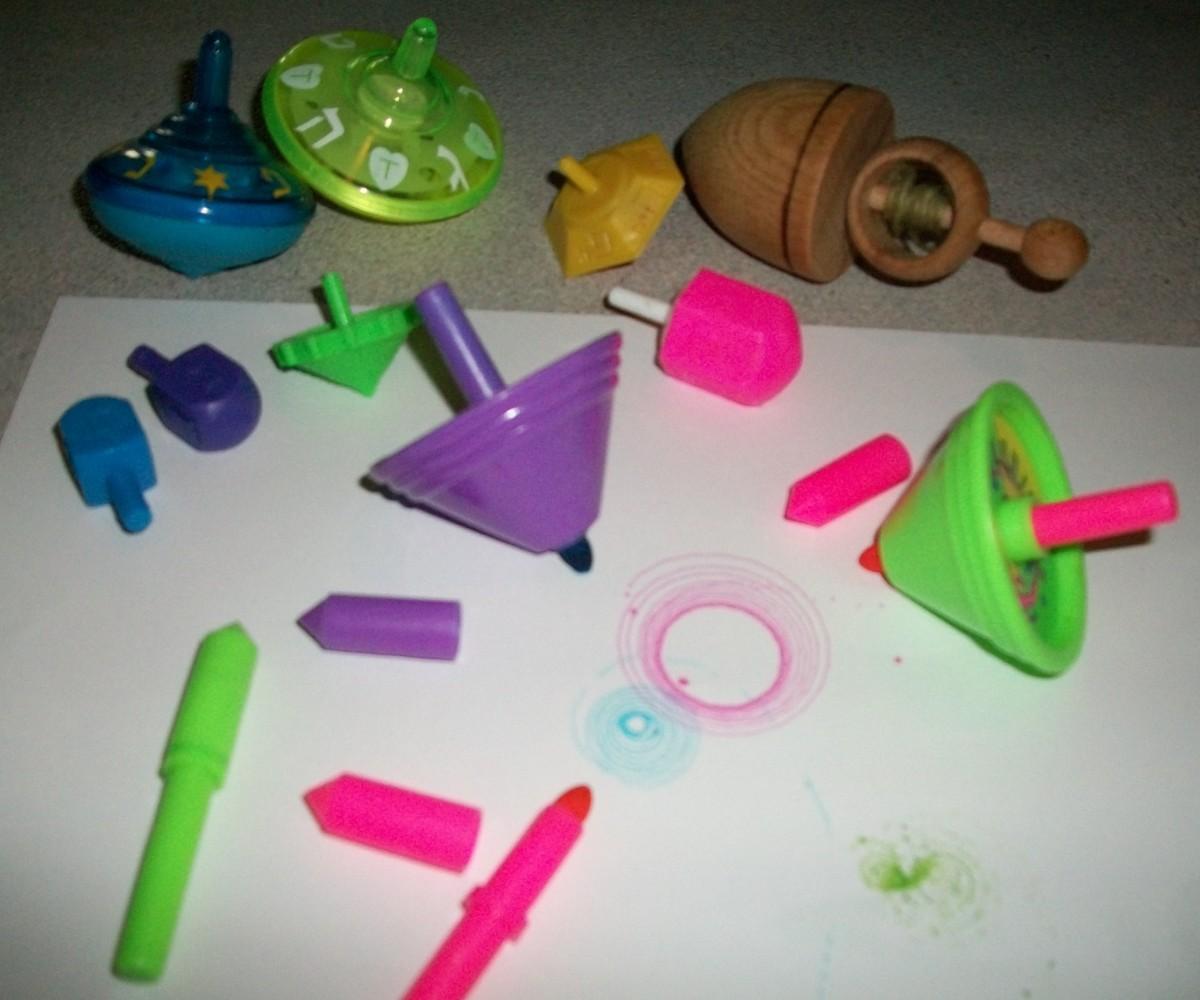 Leftovers of Reuven's dreidels. He used to have a whole box! Musical dreidels, dreidels that draw circles, etc.