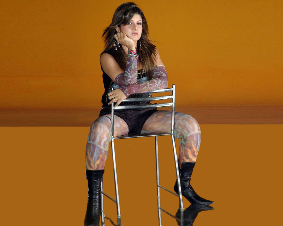 Rambha in a chair