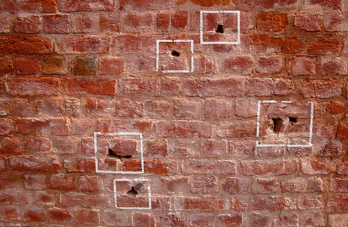 Just a few of the million bullet holes still present in Jallianwala Bagh till today (marked with chalk)