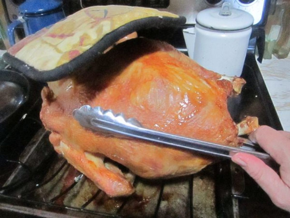 I used a potholder and tongs to turn my turkey. To make it easier, you don't have to turn a turkey, but I do prefer to have both sides well-browned.