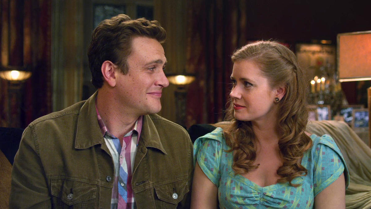 Jason Segel (left) and Amy Adams play the love-struck human duo with the necessary hubris...