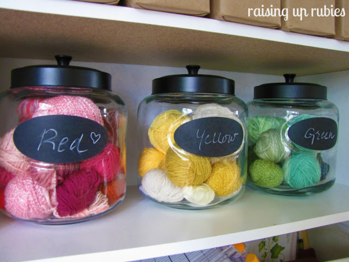 Storing yarn in these glass jars is a lovely way to add color to your craft space