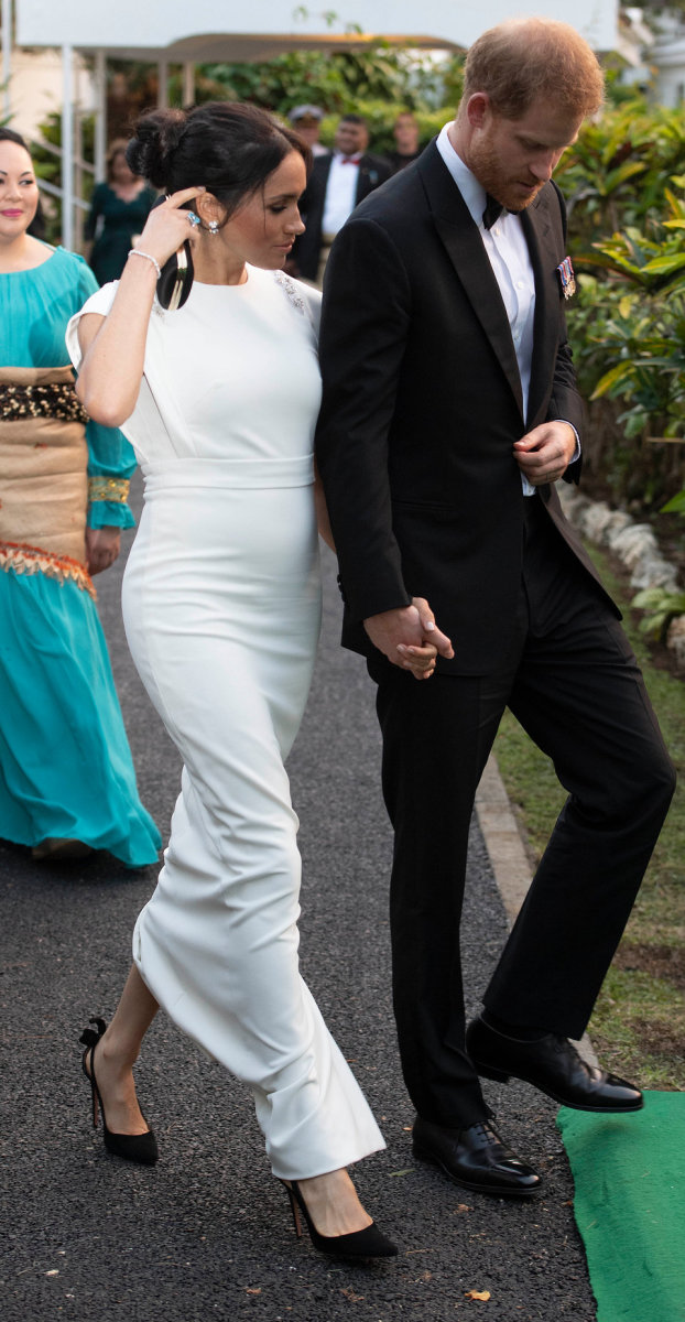The royal couple seen holding hands