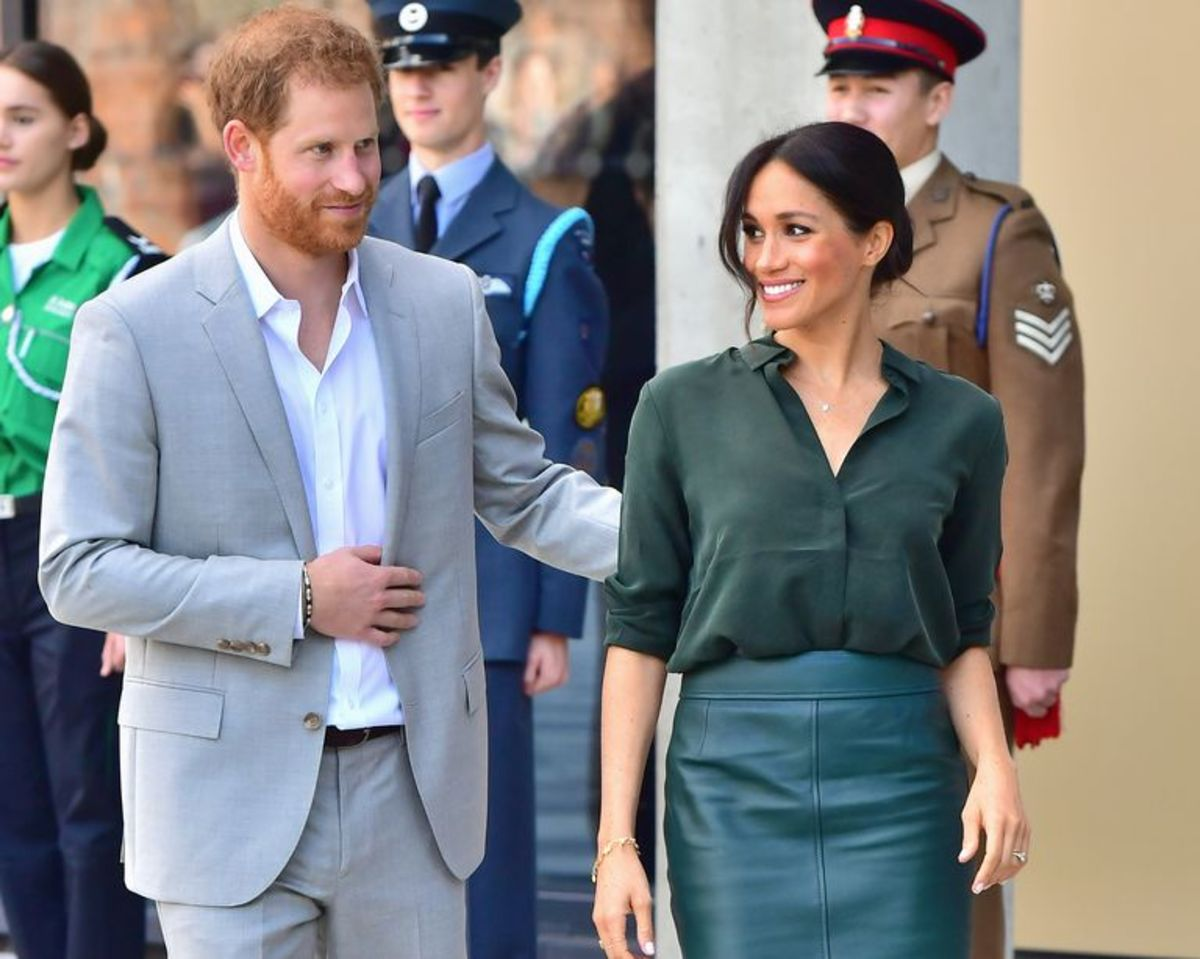 Prince Harry gently places hand on Meghan's back