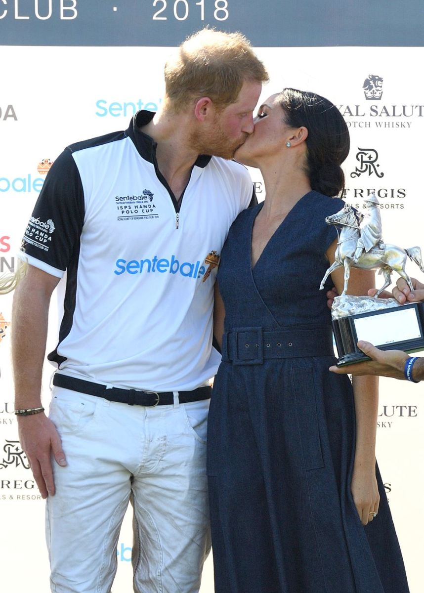 Meghan kisses Prince Harry after he won a polo match in 2018.