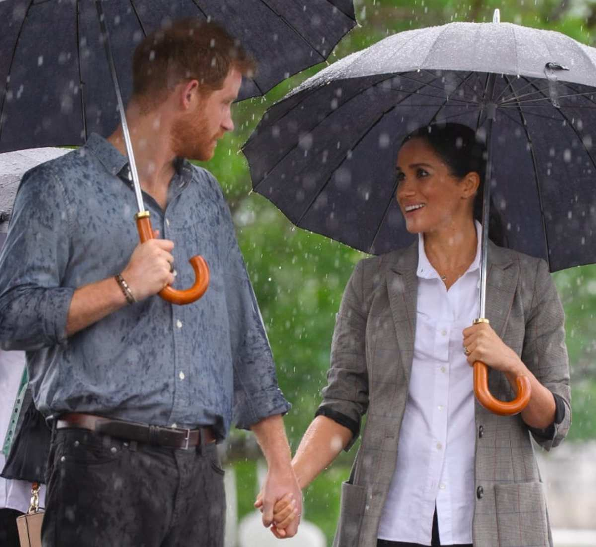 The royal couple gazing in each other's eyes as they hold hands