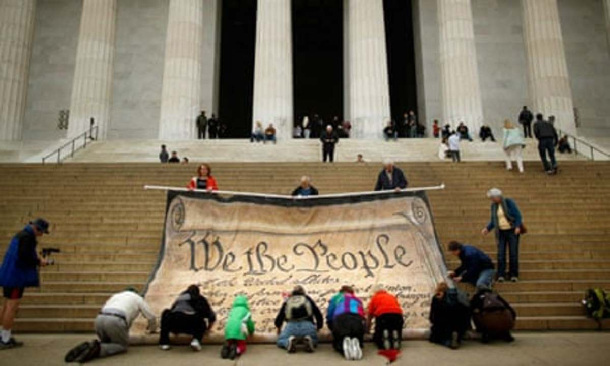 Protesters against the supreme court decision on corporate political spending roll up a giant version of the US constitution, the 'most powerful statement of democratic principle … ever written'.