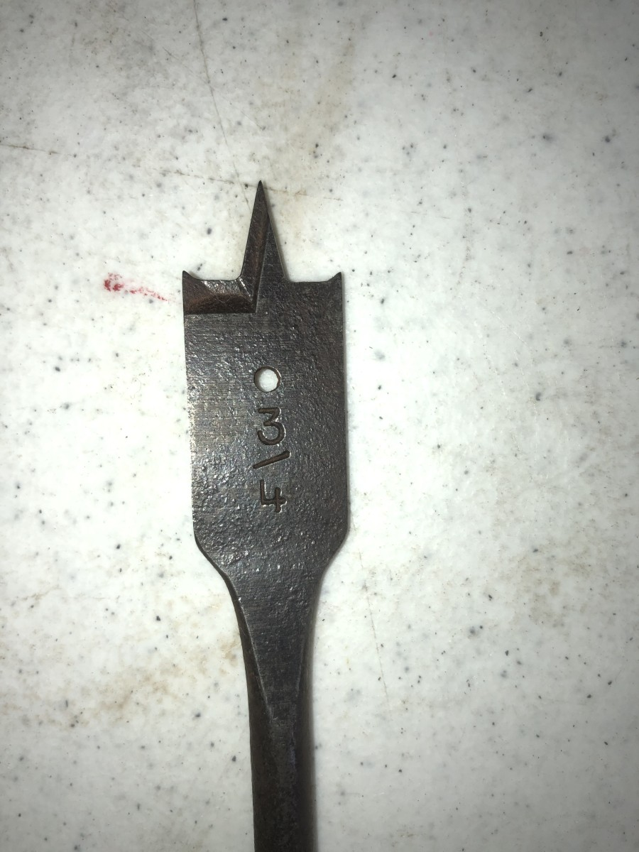 Use a spade drill bit to quickly bore holes through wood.