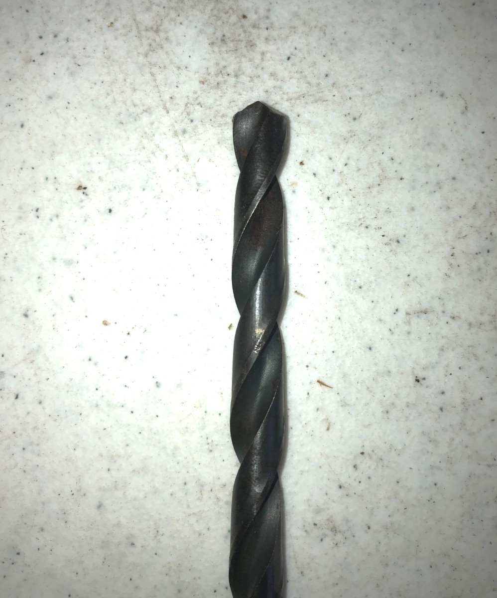 The most common type of drill bit for home use, the twist bit works on both metal and wood.
