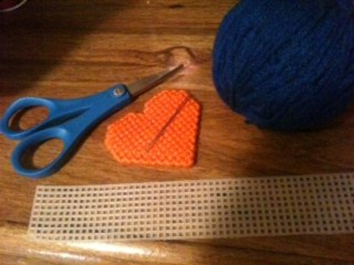Common materials used for plastic canvas crafting.