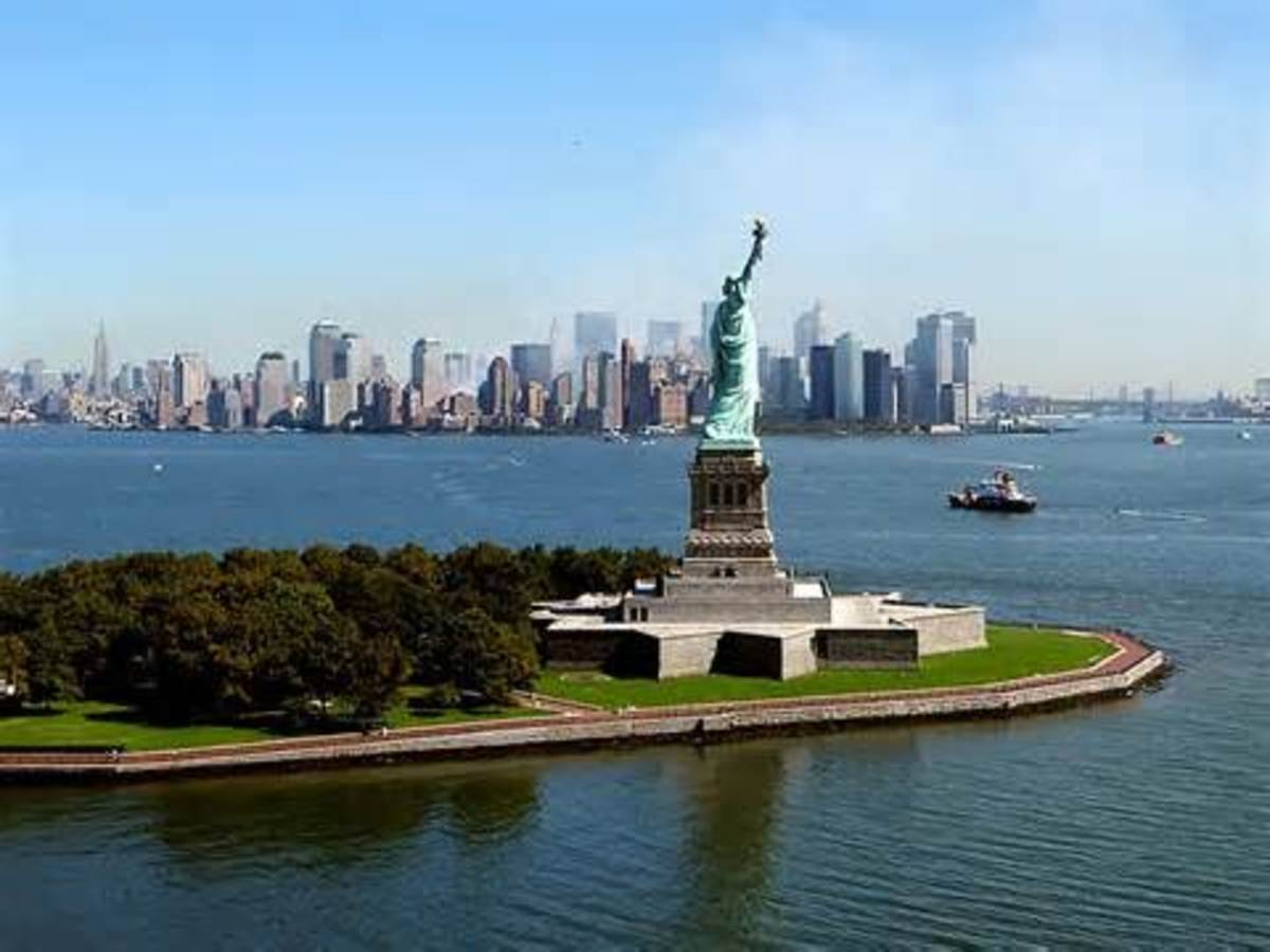 Lady Liberty's torch is lifted high, as a beacon, so that a world may see...what LIBERTY looks like!