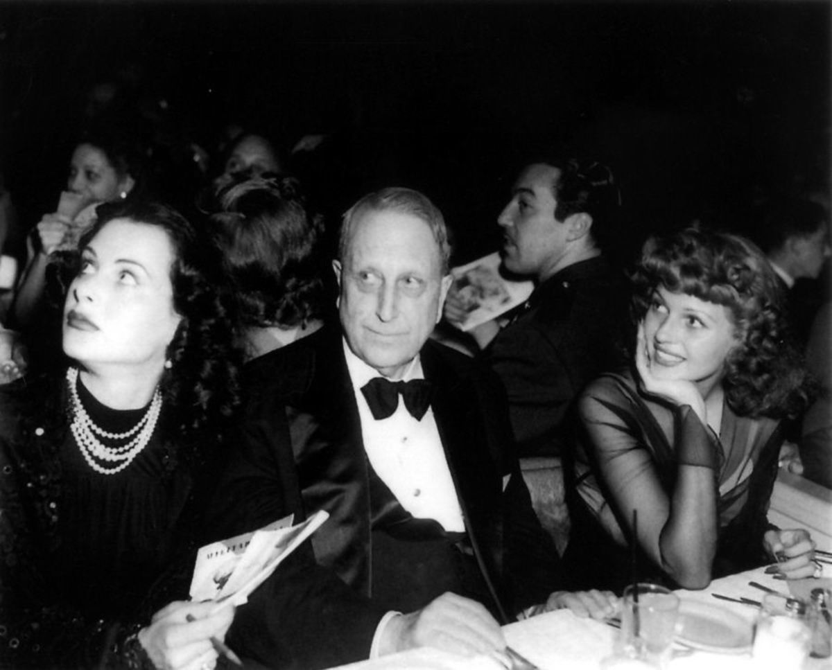 Hedy Lamarr (Left), Louis B. Mayer (Center), Rita Hayworth (Right)