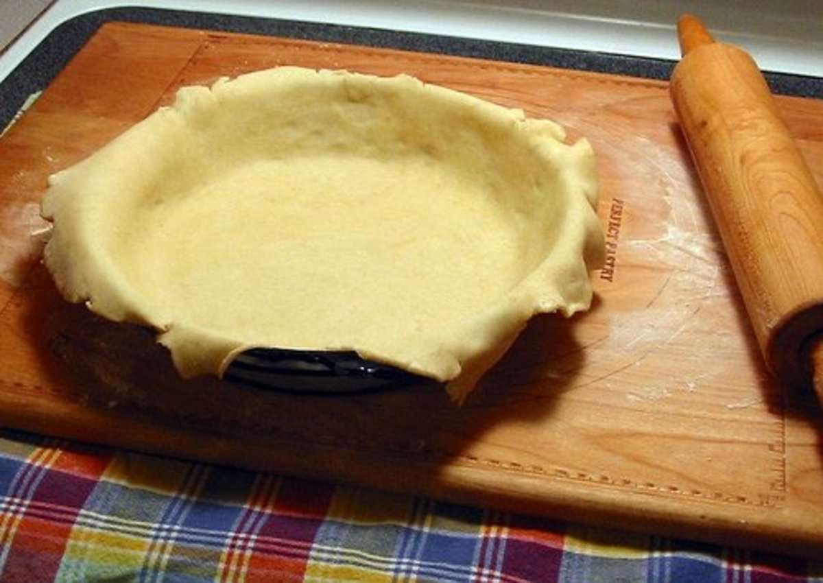 Pie crust ready for trimming http://www.flickr.com/photos/grandgrrl/4181053469/