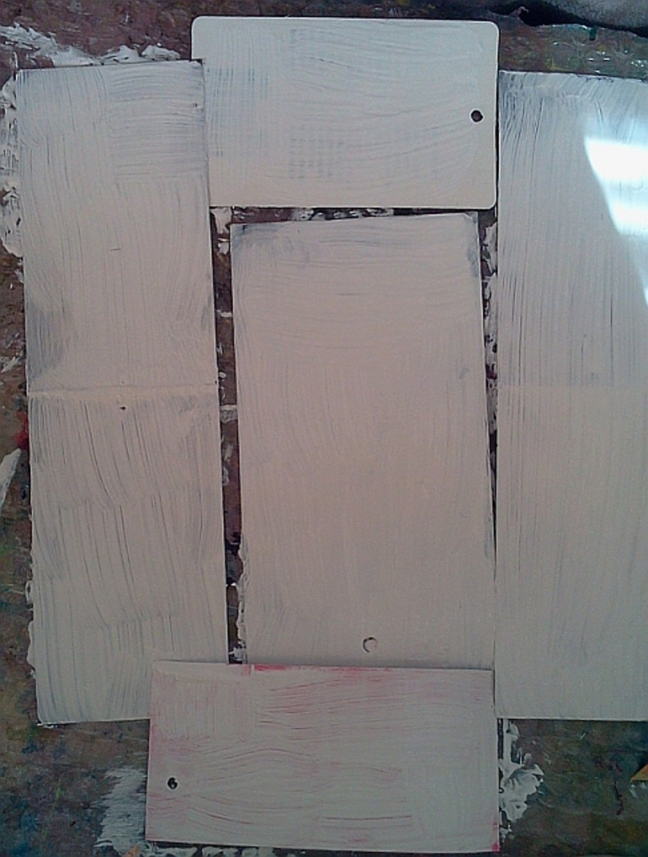 Give the tags one or two coats of gesso.