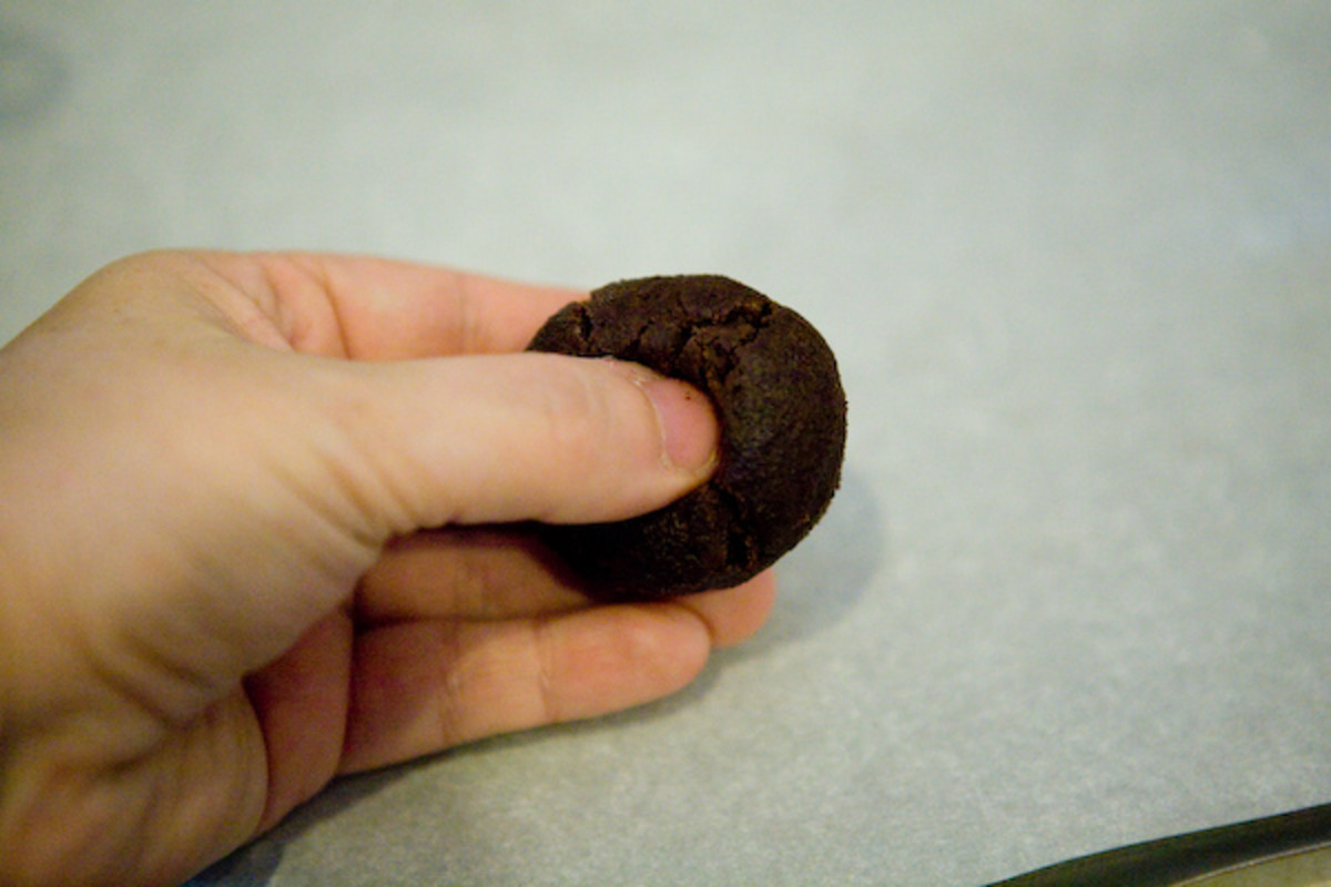 Using your thumb, press an indentation into the center of the cookie.