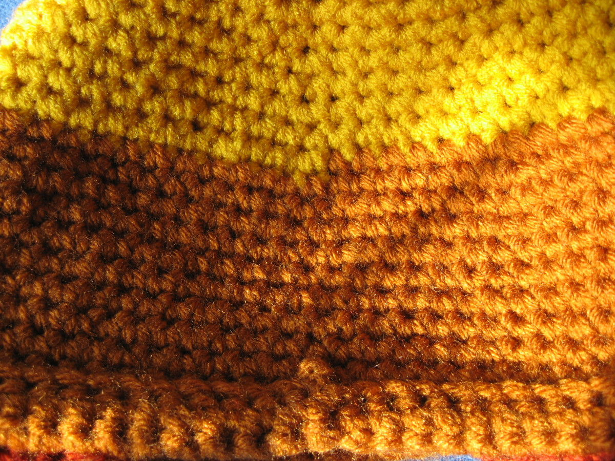 This shows the back of the hat.  You can see where the yarn color changes.  You can also see that the bottom edge has been folded up (towards outside of hat) and chain-stitched to form a rolled brim.