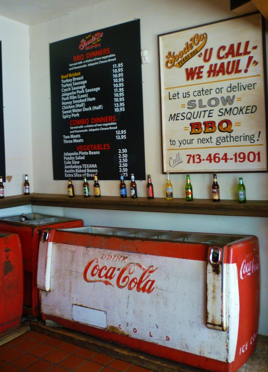 Menu on wall and drink selections can be picked up out of these old Coca-Cola coolers.