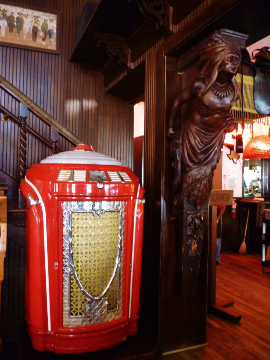 Old jukebox and carved Indian inside of Goode Co. Barbecue / Katy Freeway, Houston