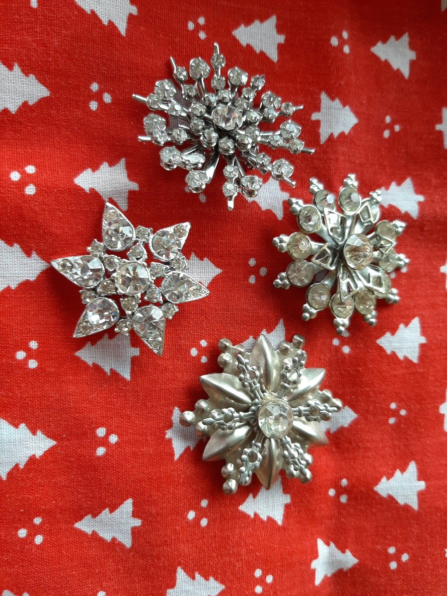 Rhinestones snowflakes are also popular among Christmas pins.