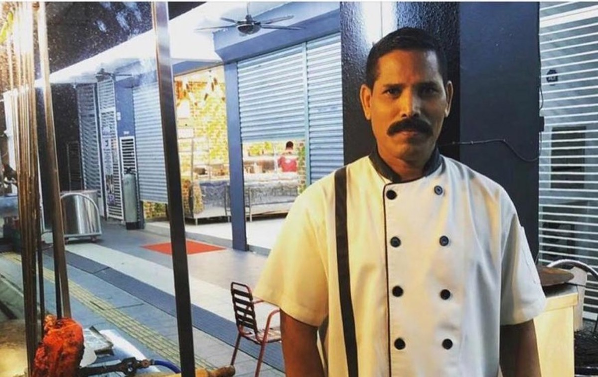 "A ""Mamak"" cook who resembles the late, Freddie Mercury."