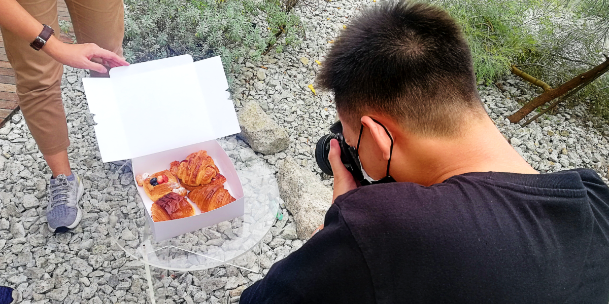 My friend, Terence Tan, getting the perfect angle to take a picture of the pastries.