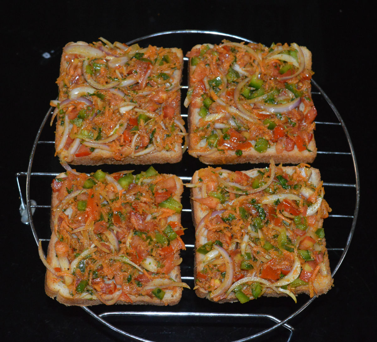 Place the stuffed bread slices on a grill stand. Place the stand in the oven and grill for 9 or 10 minutes.