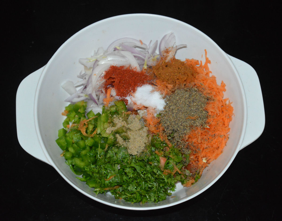 Step two: Add all the spice powders, oil, and salt as per instructions. Gently mix.