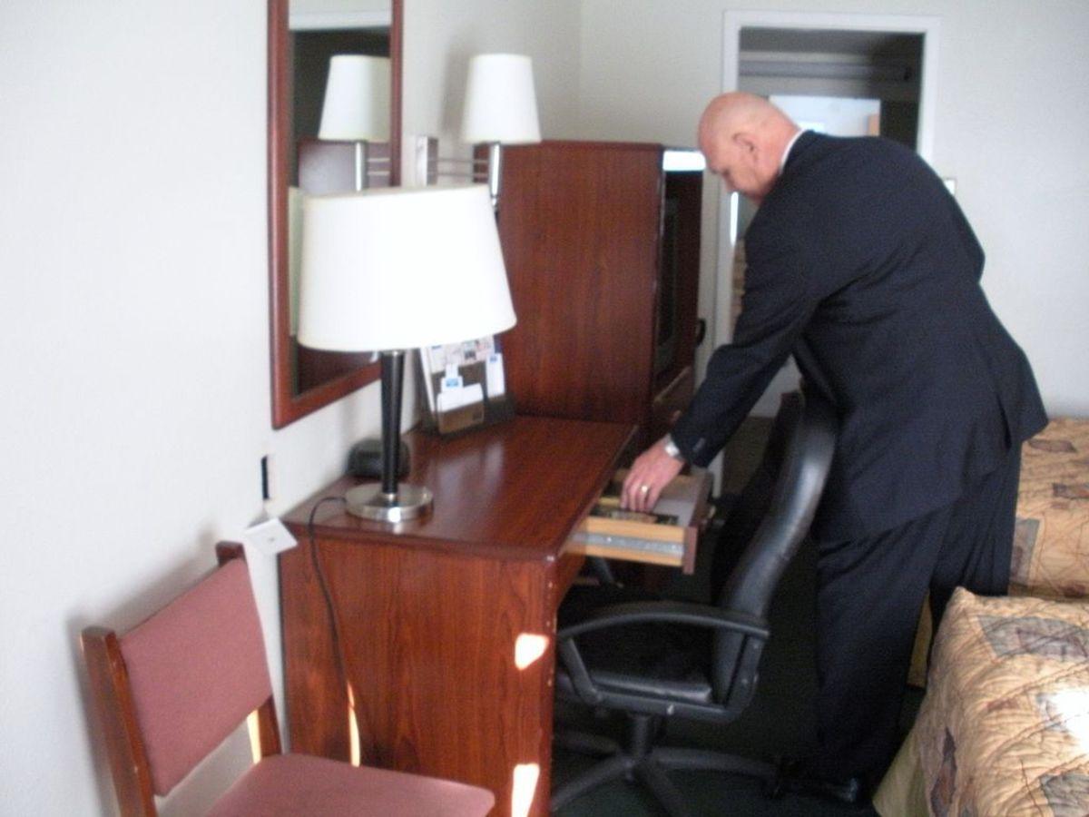 Gideon member distributing scripture in motel room