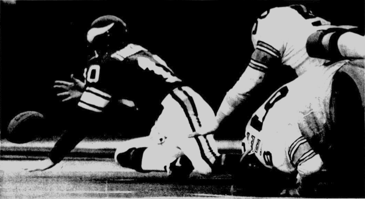 Fran Tarkenton loses a fumble during Super Bowl IX, a game which the Vikings would lose to the Steelers.