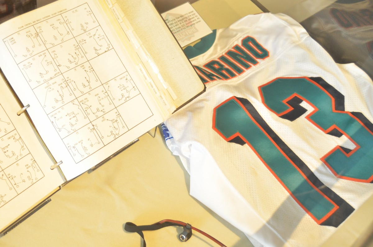 Dan Marino memorabilia is shown at the Pro Football Hall of Fame. Marino is the greatest quarterback in NFL history never to win a Super Bowl.