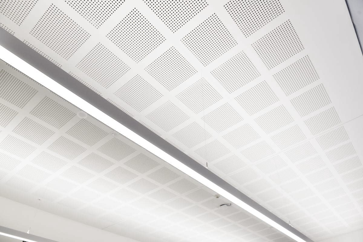 Installation of perforated ceilings with sound absorptive insulation
