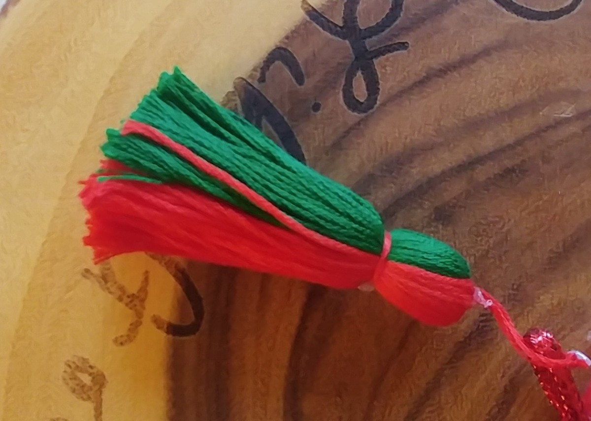 This is a homemade tassel, but tassels can be found in craft stores. This one is a two colored red and green tassel, however the color of tassel is optional.