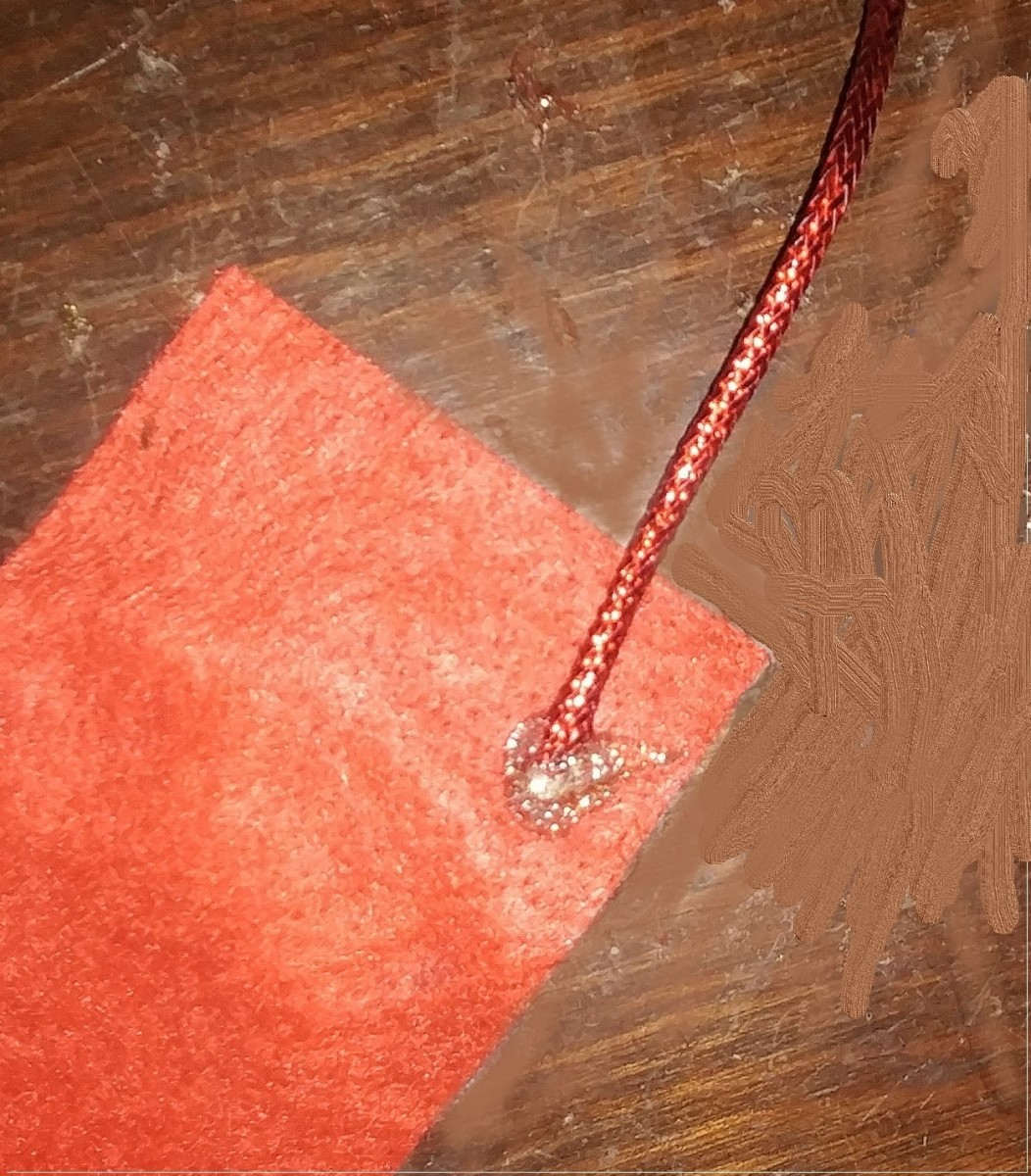 Yarn works well for this bookmark. I used a shiny yarn, but soft red yarn works as well.