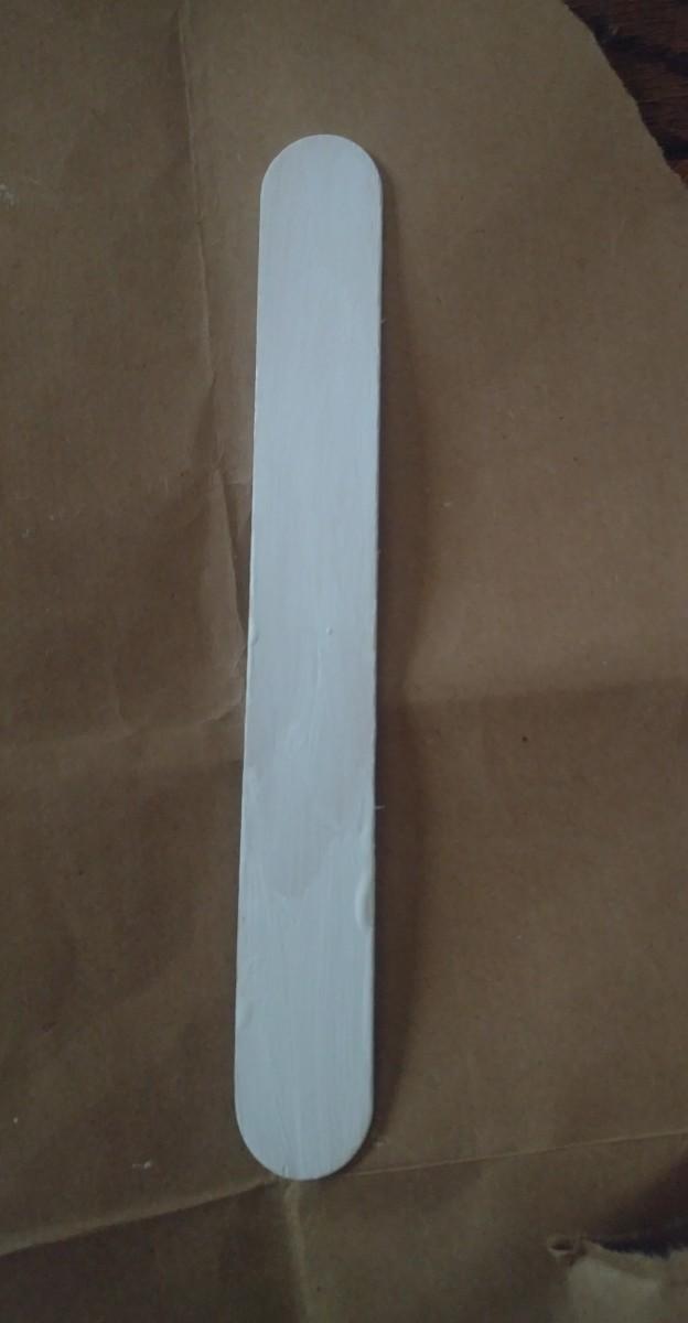 Paint lollipop stick white.