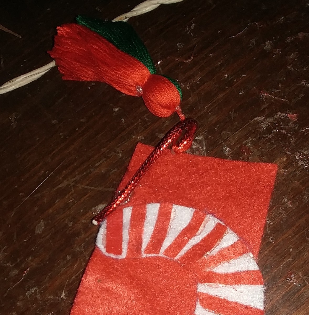 Slip tassel through yarn, and glue the end on the front of bookmark.
