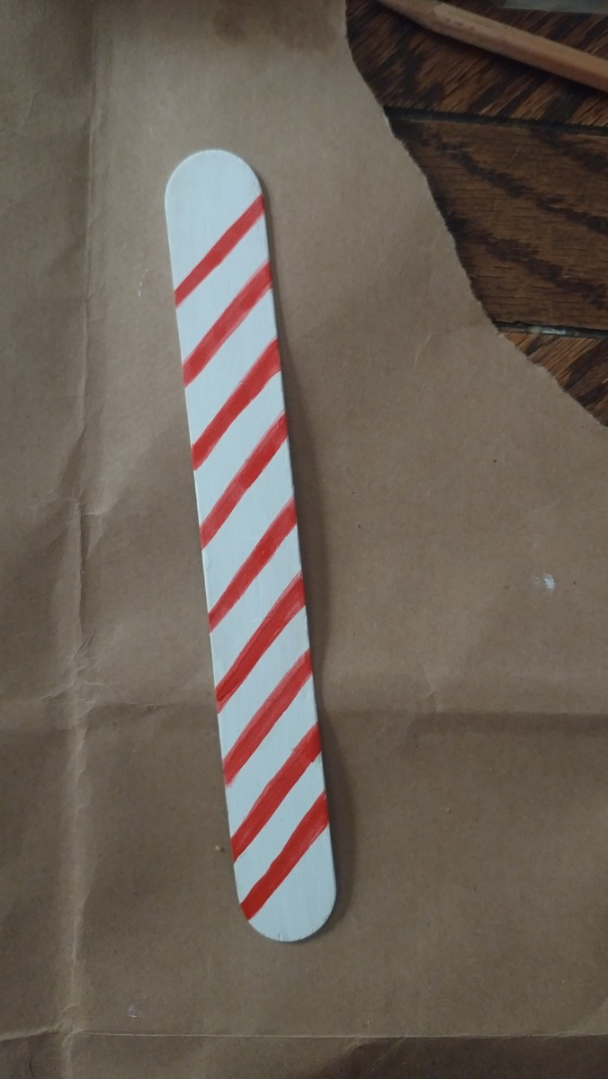 Pain red stripes on to the lollipop stick. I painted slanted stripes to give an effect.